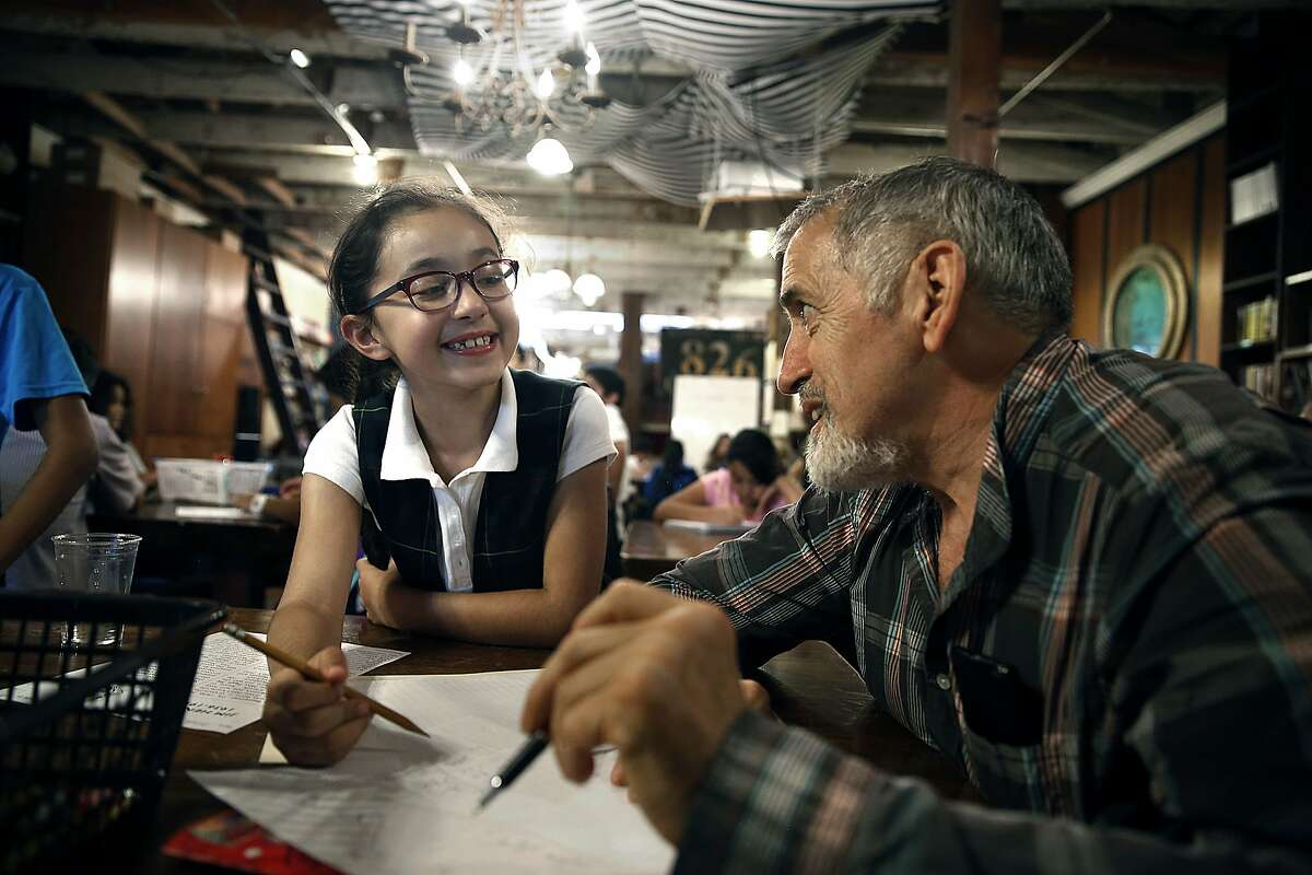 Brenda Hernandez (left), 7 years old, gets help from tutor Clint Seiter (right) in the creative-writing tutoring program at 826 Valencia St. in San Francisco, Calif., on Thursday, September 24, 2015.
