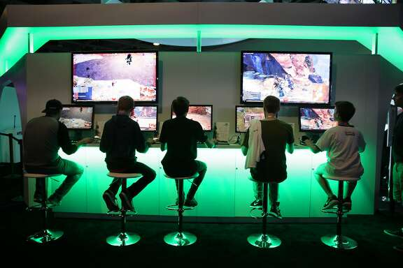 Twitchcon attendees play Guild Wars 2: Heart of Thorns at the ArenaNet booth during Twitchcon at Moscone West on Friday, September 25, 2015 in San Francisco, Calif.