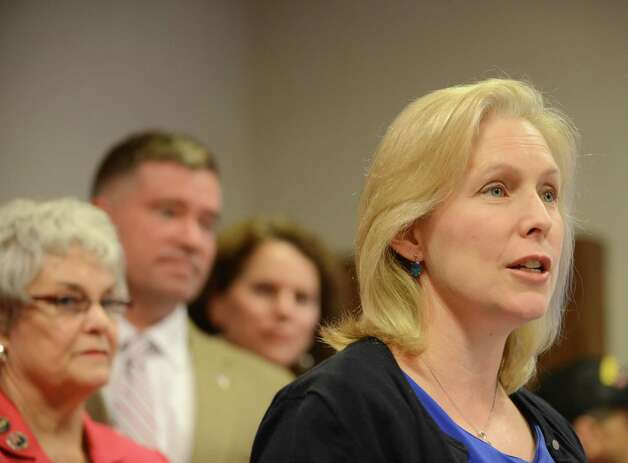 Sen. Kirsten Gillibrand, right, speaks during a news conference where she and Rep. Chris Gibson, second from left, called for passage of legislation that would include veterans who served in the waters surrounding Vietnam among a group presumed to have been exposed to Agent Orange. They spoke on Monday, July 6, 2015, at the Joseph E. Zaloga American Legion Post 1520 in Colonie, N.Y. (Will Waldron/Times Union) Photo: WW / 00032505A