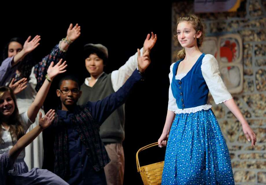 Central Middle School 8th grader, Cara Williams, plays the lead role of Belle during a dress rehearsal for Beauty and the Beast, Jr., at Central Middle School, Wednesday afternoon March 24th, 2010. Photo: Bob Luckey / Greenwich Time