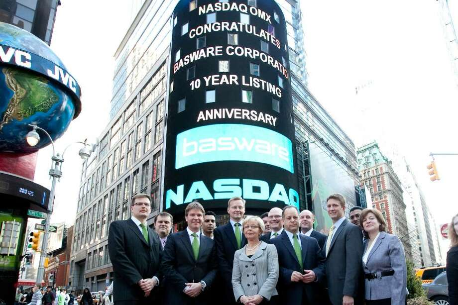 Employees and guest of Basware, a Finnish software company with U.S. headquarters in Stamford, pose outside the Nasdaq Stock Market in New York last week following a closing bell ceremony at which CEO Ilkka Sihvo rang the bell.  At center is Finnish Consul General Ritva Jolkkonen; Sihvo stands behind her right shoulder; to her left in the front row is Robert Cohen, Basware's marketing director, Ari Salonen, Basware's general manager of North America, stands in the second row between Cohen and Jolkkonen. Photo: Contributed Photo / Stamford Advocate Contributed
