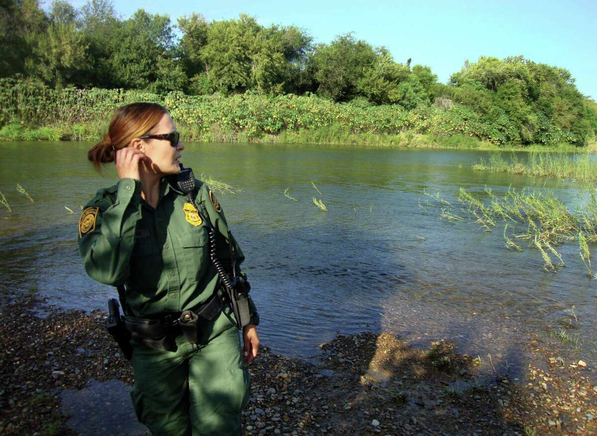 U.S. Customs and Border protection Agent Erica Sanchez, , searches for immigrants on the banks of the Rio Grande near Roma. She may not be successful - the net flow from Mexico is essentially zero, experts say.