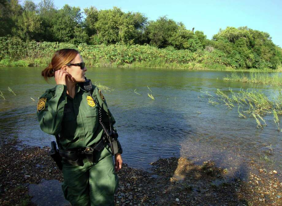 U.S. Customs and Border protection Agent Erica Sanchez, , searches for immigrants on the banks of the Rio Grande near Roma. She may not be successful — the net flow from Mexico is essentially zero, experts say. Photo: Molly Hennesy-Fiske /Los Angeles Times / Los Angeles Times