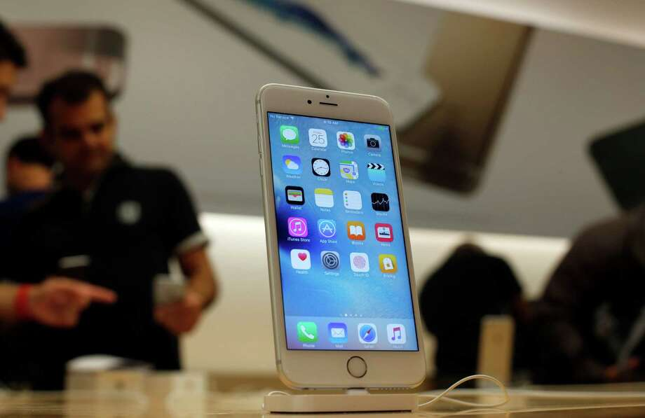 A new Apple iPhone 6S is displayed at an Apple store on Chicago's Magnificent Mile, Friday, Sept. 25, 2015, in Chicago. (AP Photo/Kiichiro Sato) Photo: Kiichiro Sato, STF / AP