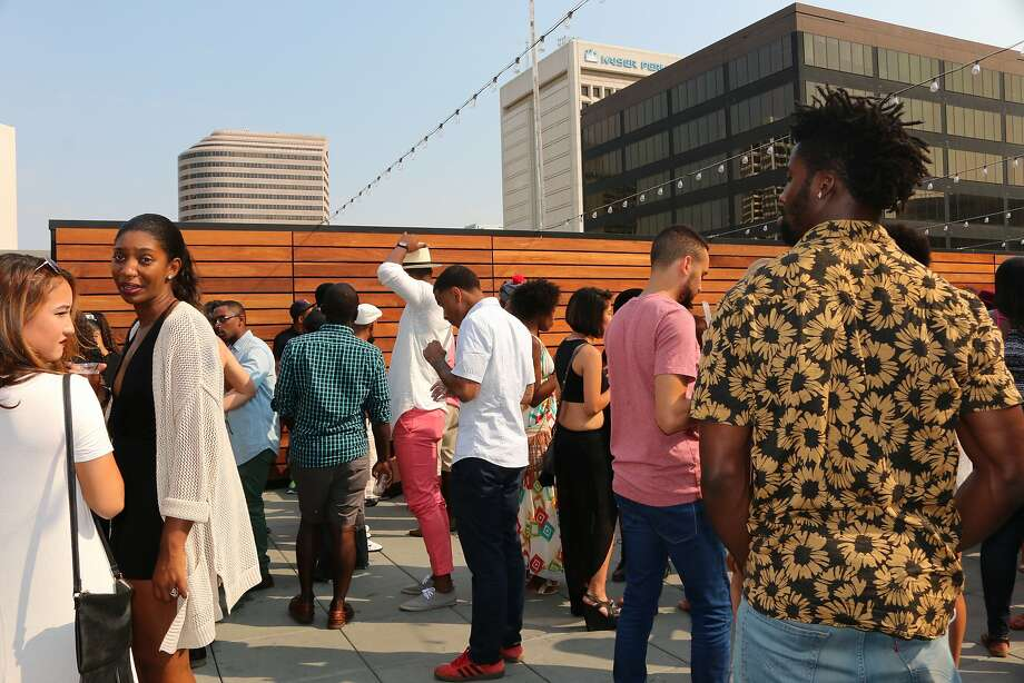 Partygoers enjoying the festivities of Toasted Life's day party on Sept. 13 at the Magnin Rooftop Lounge in Oakland, CA. Photo: Spencer Whitney, San Francisco Chronicle