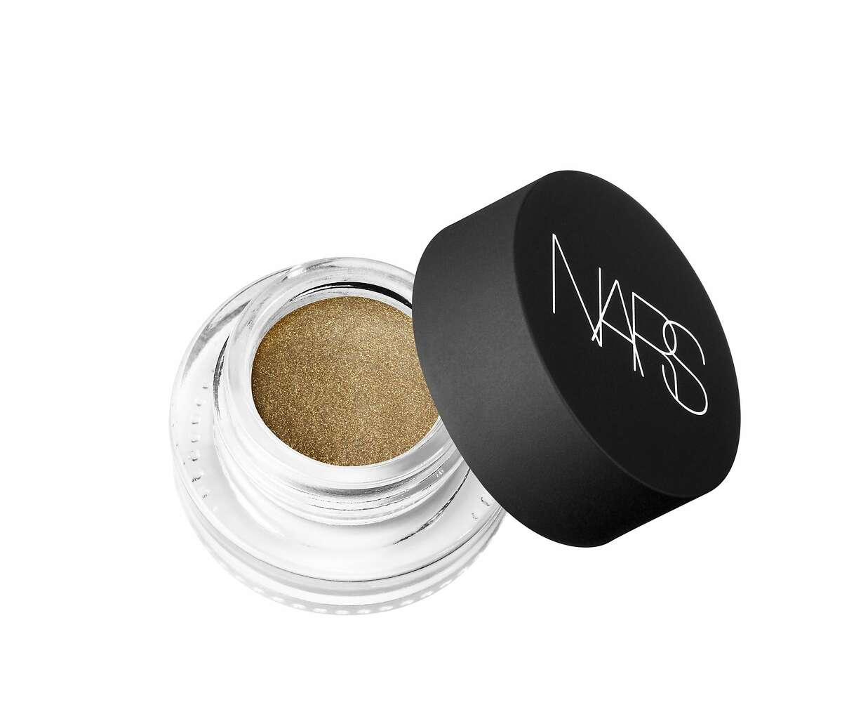 At Creatures of the Wind, Aaron de Mey for NARS Cosmetics channeled punk rocker Siouxsie Sioux when he came up with the tough girl matte black cat eye, hugged by a block of saturated sparkling gold via NARS Eye Paint in Iskander (available at NARSCosmetics.com).