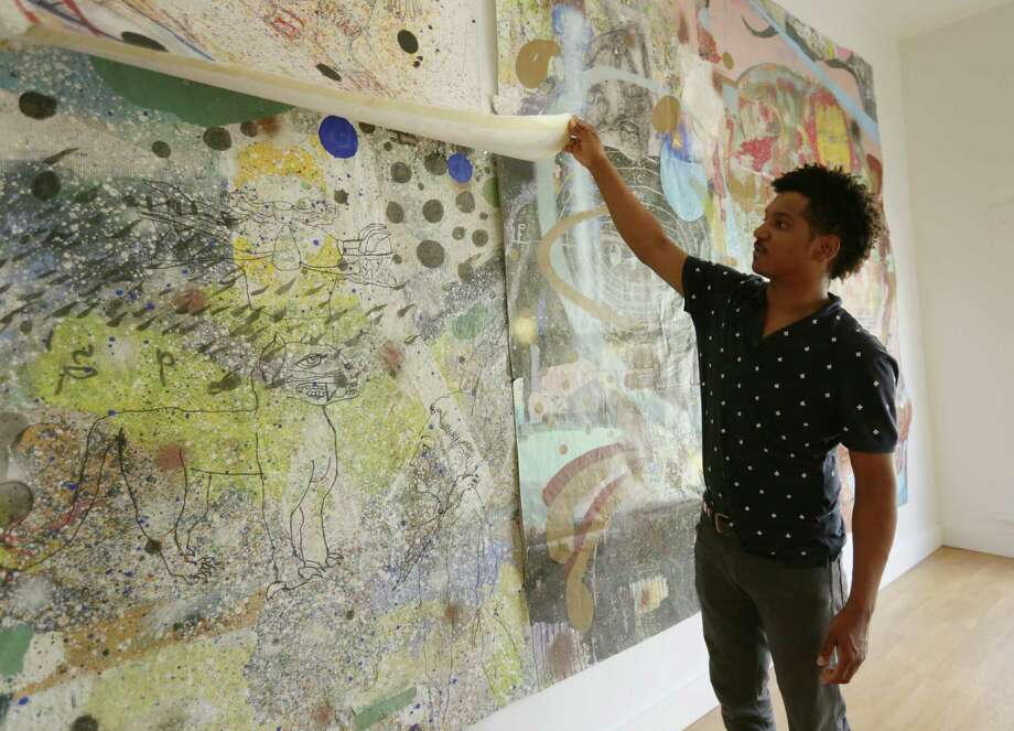 "Artist Angelbert Metoyer shows off his work ""Number 14"" at the Gspot Gallery annex Thursday, Sept. 24, 2015, in Houston. ( Jon Shapley / Houston Chronicle ) Photo: Jon Shapley, Staff / © 2015 Houston Chronicle"