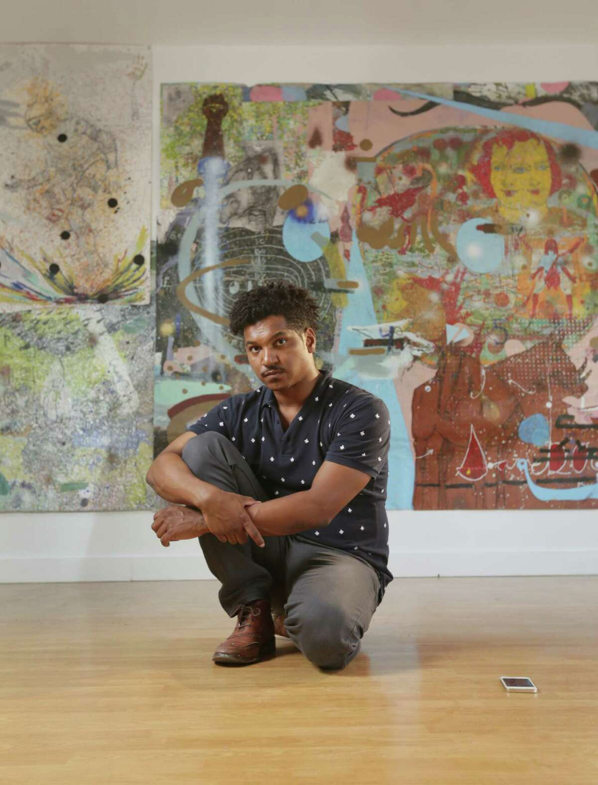 """Artist Angelbert Metoyer shows off his work """"Number 14"""" at the Gspot Gallery Annex."""