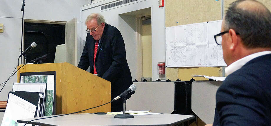 John Fallon, attorney for a senior housing project proposed for Mill Hill Terrace, addresses the Inland Wetlands Commission Thursday, while David Rosenstein, an Acorn Lane resident and intervenor in the permit application, listens. Photo: Genevieve Reilly /Fairfield Citizen /  Fairfield Citizen contributed