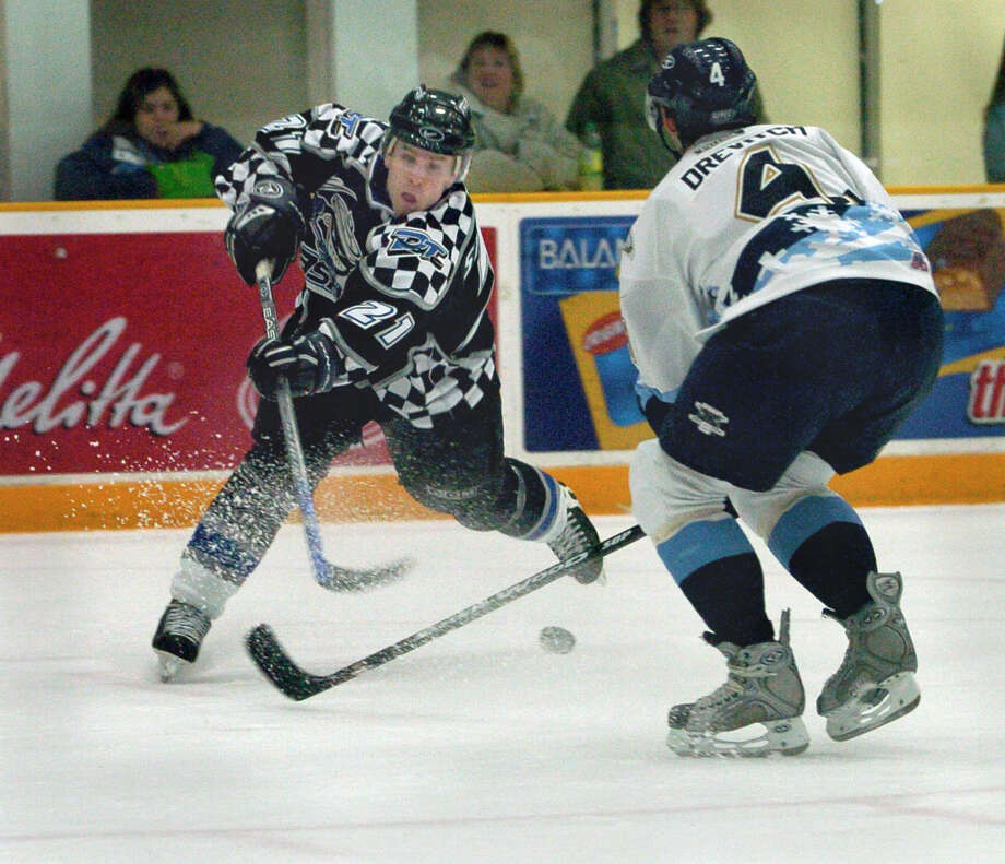Trashers ice hockey vs Adirondack: left, Trashers # 21Danny Stewart right, Adirondack #4,Scott Drevitch Photo: Carol Kaliff