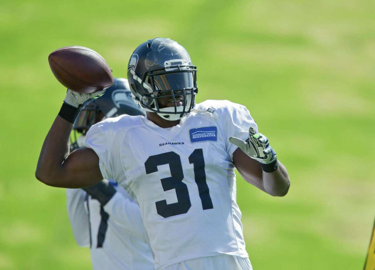 Seattle Seahawks' Kam Chancellor (31) attends NFL football practice for the first time after holding out over a contract dispute, on Wednesday, Sept. 23, 2015 at the team headquarters in Renton, Wash. (AP Photo/John Froschauer)