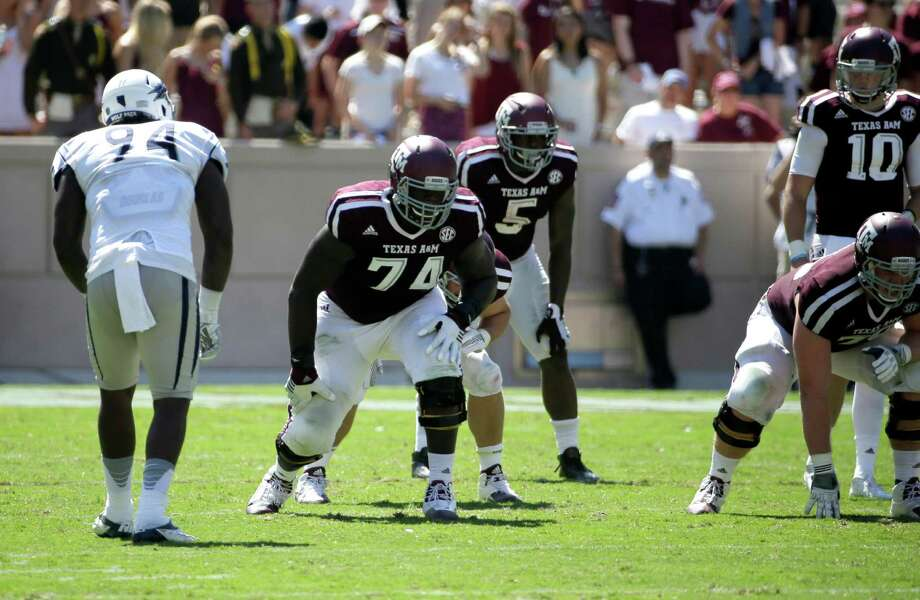 Texas A&M offensive lineman Germain Ifedi (74) lines up against Nevada defensive end Lenny Jones (94) during the first half of an NCAA college football game Saturday, Sept. 19, 2015, in College Station, Texas. Photo: David J. Phillip /Associated Press / AP
