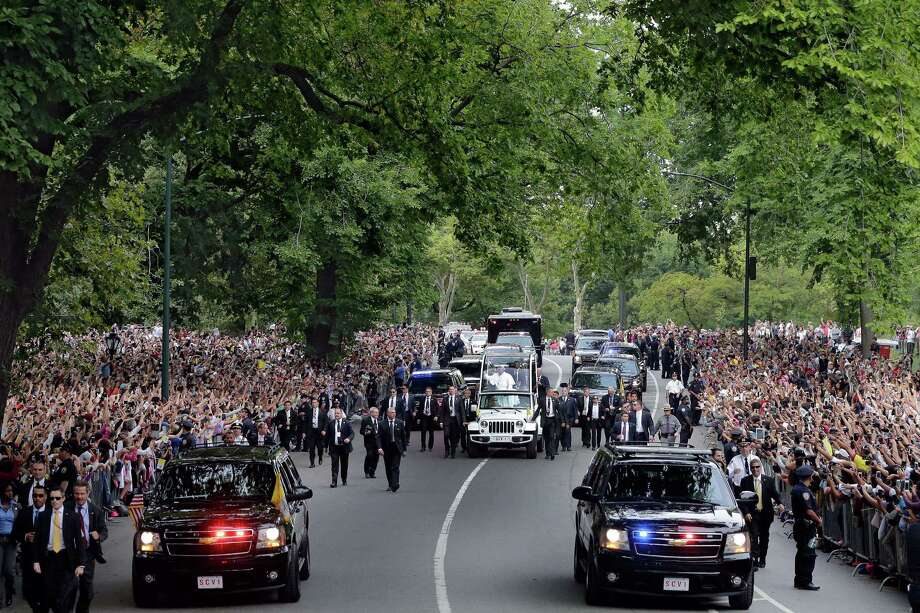 Pope Francis  his motorcade in New York's Central Park, September 25, 2015.      AFP PHOTO / Pool / Richard DREWRICHARD DREW/AFP/Getty Images Photo: RICHARD DREW, AFP / Getty Images / AFP
