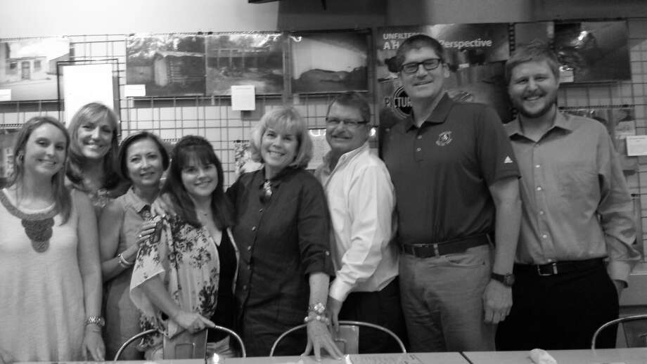 Many helped launch the Picture This Homeless Youth exhibit at Phoenicia Specialty Foods, including (from left) Paige Shugart, HomeAid Houston; Judy Bonica, HomeAid board member; Debbie Howard, GHBA; Tasha Steiner, board member; Bette Moser, HomeAid Houston; Ron Martin, board member; Greg Tomlinson, board member; and Zach Martin, HomeAid guest. Phoenicia is adjacent to Discovery Green downtown.