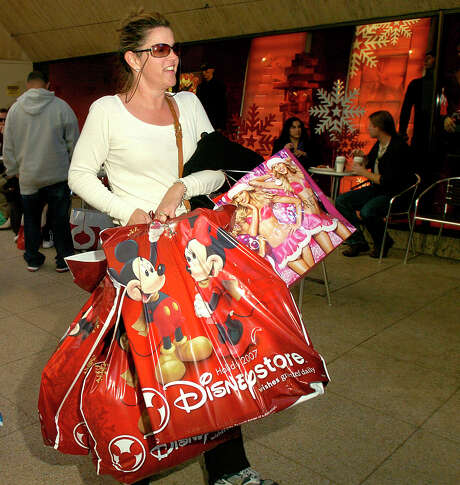 In addition to putting aside cash for your holiday spending, experts also recommend shopping early for deals. Photo: Associated Press File Photo / AP