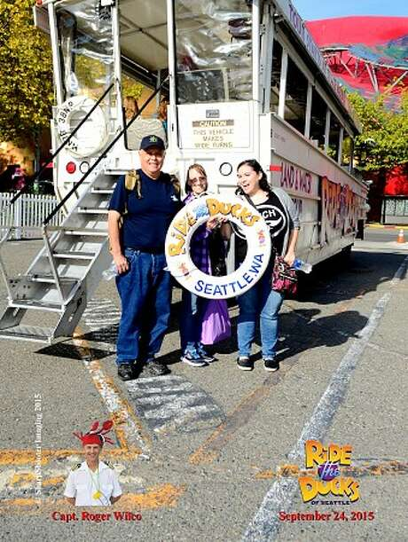 "Seattle Ride the Ducks passengers Greg Moody, Patricia Moody and Katie Moody are pictured Thursday, minutes before the Duck boat they were riding on spun out of control and hit a charter bus on the Aurora Bridge. Four passengers on the bus were killed. Katie and Patricia Moody were in satisfactory condition Friday at Harborview Medical Center in Seattle, while Greg Moody had been released shortly after the crash. It wasn't immediately clear whether the ""captain"" pictured in the photo was behind the wheel when the crash occurred. Photo: Provided By The Moody Family"