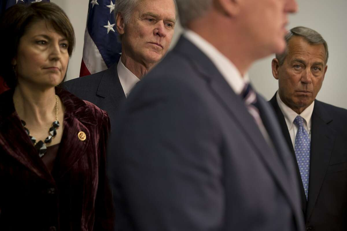 FILE -- House Speaker John Boehner (R-Ohio), right, looks on as Majority Leader Kevin McCarthy (R-Calif.), foreground, speaks following a meeting of House Republicans and Boehner's proposed vote to condemn the president's immigration reforms during the impending government shutdown, in Washington, Dec. 2, 2014. After Boehner's stunning decision on Friday, Sept. 25, 2015, to step down, most Republicans have mentioned McCarthy as the most likely successor. From left: Rep. Cathy McMorris Rodgers (R-Wash.), Rep. Ander Crenshaw (R-Fla.), McCarthy and Boehner. (Stephen Crowley/The New York Times)