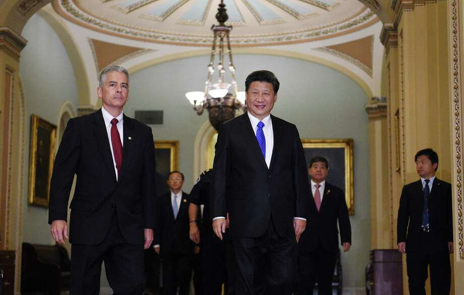 WASHINGTON, DC - SEPTEMBER 25: China's President Xi Jinping, accompanied by Frank Larkin, US Senate Sgt. at Arms, arrives on Capitol Hill September 25, 2015 in Washington, DC. President Jinping met with the leadership of the US Senate and US House as part of his official state visit. (Photo by Astrid Riecken/Getty Images) Photo: Astrid Riecken, Stringer / Getty Images / 2015 Getty Images