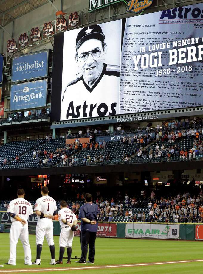 "Houston Astros take a moment of silence in tribute of baseball legend Yogi Berra before a baseball game against the Los Angeles Angels, Wednesday, Sept. 23, 2015, in Houston. Berra, who filled baseball's record book as well as ""Bartlett's Familiar Quotations,"" died Tuesday of natural causes at his home in New Jersey, according to Dave Kaplan, the director of the Yogi Berra Museum.  He was 90. (AP Photo/Pat Sullivan) Photo: Pat Sullivan, STF / AP"