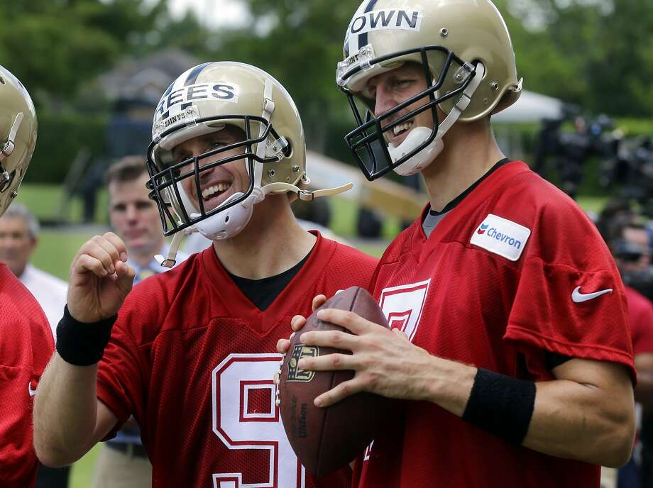 Saints quarterback Drew Brees (left) will be replaced by Luke McCown (right) for New Orleans' game at Carolina on Sunday. Brees is recovering from a bruised rotator cuff. Photo: Gerald Herbert, Associated Press