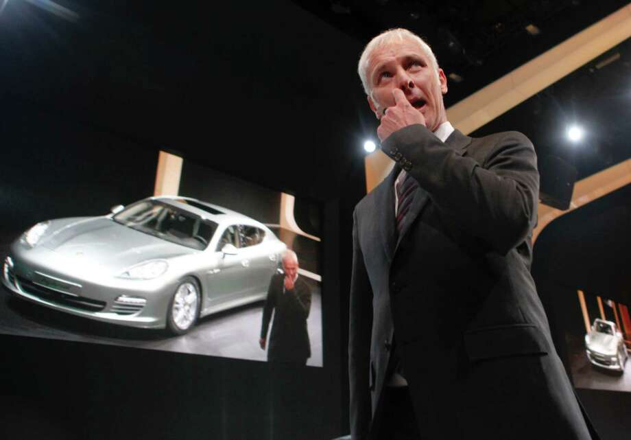 FILE - In this Feb. 28, 2011 file photo Matthias Mueller, chairman of the board of Porsche AG gestures as he presents the new Porsche Panamera hybrid car  during a presentation of VW (Volkswagen) prior to the 81st International Motor show in Geneva, Switzerland. Volkswagen announced in a news conference after its supervisory board meeting in Wolfsburg, Germany, Friday, Sept. 25, 2015, that Mueller will follow Martin Winterkorn, who resigned this week as CEO of the company. (AP Photo/Anja Niedringhaus, File) Photo: Anja Niedringhaus, STF / AP