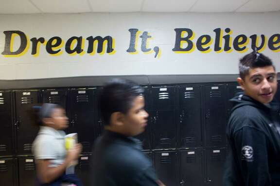 Students walk through the halls of Fondren Middle School where words of encouragement are painted throughout the school as more than 203,000 students at HISD attended their first day of classes Monday, Aug. 25, 2014, in Houston. ( Johnny Hanson / Houston Chronicle )