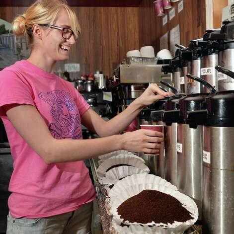 Javateer Amelia Beach pours a cup of the coffee of the day, pecan sticky bun, at Professor Java's coffee house Friday Sept. 25, 2015 in Colonie, NY.  (John Carl D'Annibale / Times Union) Photo: John Carl D'Annibale