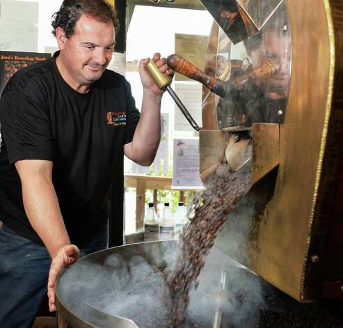 Owner and roastmaster Frank Figliomeni prepares Bali Blue Moon coffee beans at his Professor Java's coffee house Friday Sept. 25, 2015 in Colonie, NY.  (John Carl D'Annibale / Times Union) Photo: John Carl D'Annibale