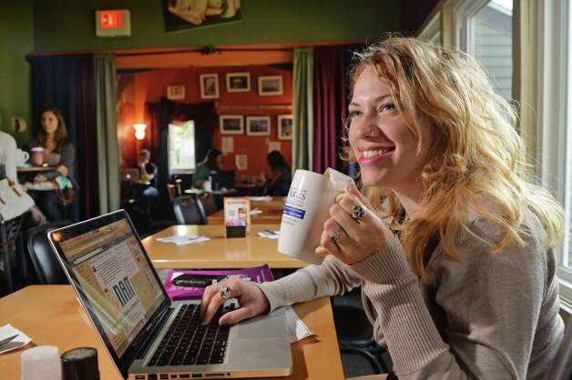 UAlbany grad student MalloryHallstead with her second cup of the day at Professor Java's coffee house Friday Sept. 25, 2015 in Colonie, NY.  (John Carl D'Annibale / Times Union) Photo: John Carl D'Annibale