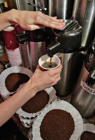 Javateer Amelia Beach pours a cup of coffee at Professor Java's coffee house Friday Sept. 25, 2015 in Colonie, NY.  (John Carl D'Annibale / Times Union) Photo: John Carl D'Annibale