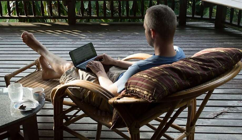 Expensify CEO David Barrett works on a patio in a rainforest in Thailand during one of the company's previous month-long getaways. Photo: Expensify