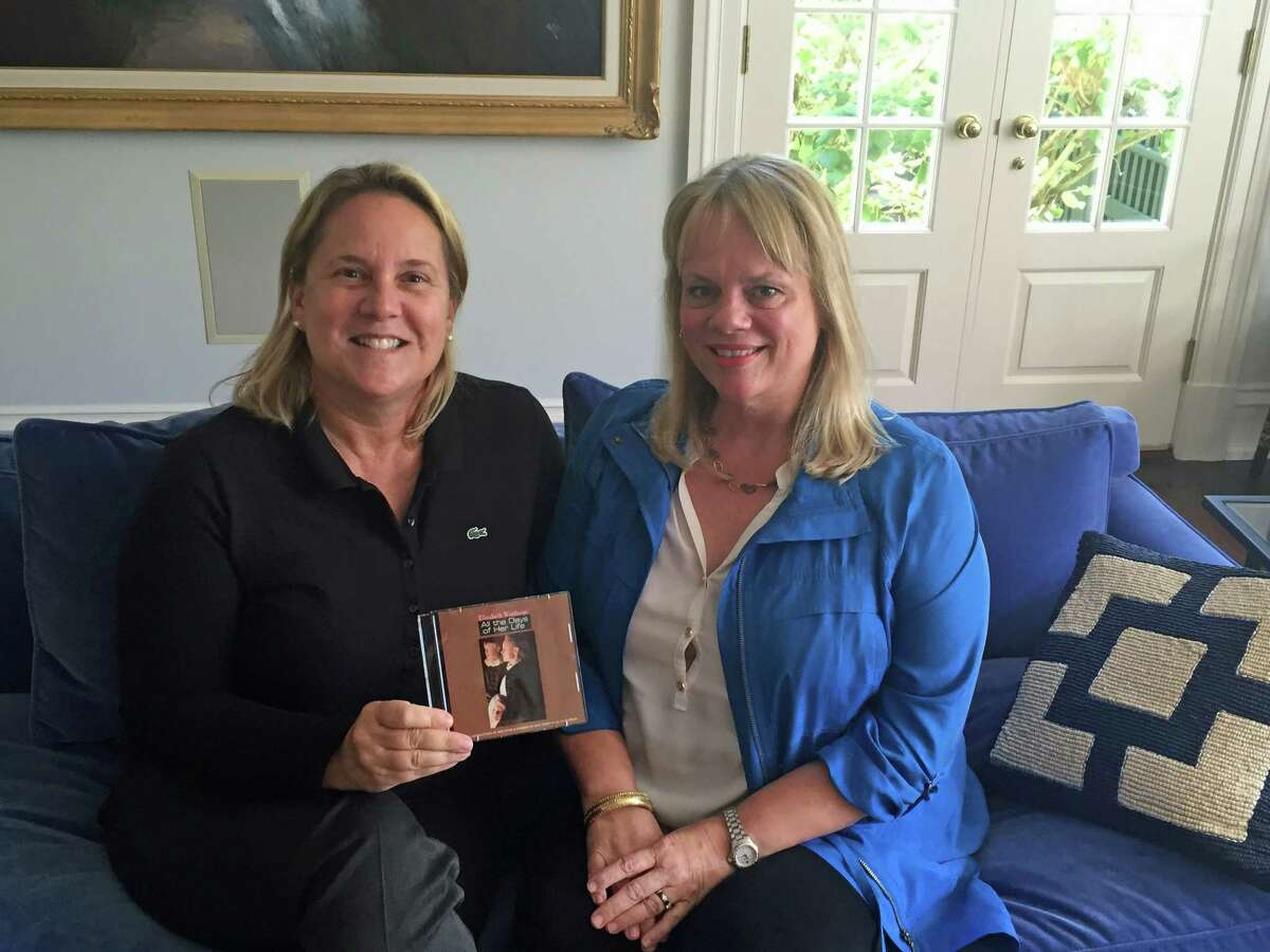 """Executive producer Amy Mooney, left, and writer/producer Joni Steele Kimberlin with a copy of """"Elizabeth Winthrop: All the Days of her Life"""" at Kimberlin's home in Greenwich. The movie will be shown at 5:30 and 7 p.m. Sunday at the Cole Auditorium in Greenwich Library."""
