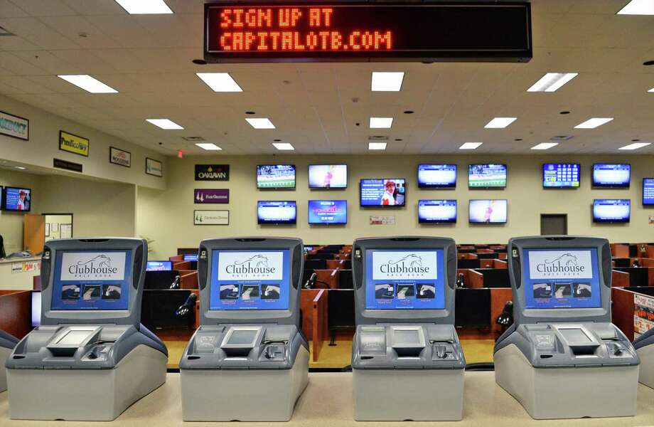 Self-serve terminals inside the Albany OTB clubhouse on Central Avenue Wednesday Feb. 4, 2015, in Albany, N.Y.  (John Carl D'Annibale / Times Union) Photo: John Carl D'Annibale / 00030436A