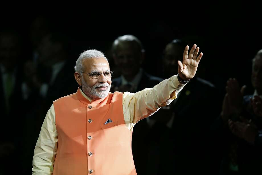 Prime Minister Narendra Modi of India waves to the crowd as he arrives to give a speech during a reception by the Indian community in honor of his visit to the United States at Madison Square Garden, Sunday, Sept. 28, 2014, in New York. Photo: Jason DeCrow, Associated Press