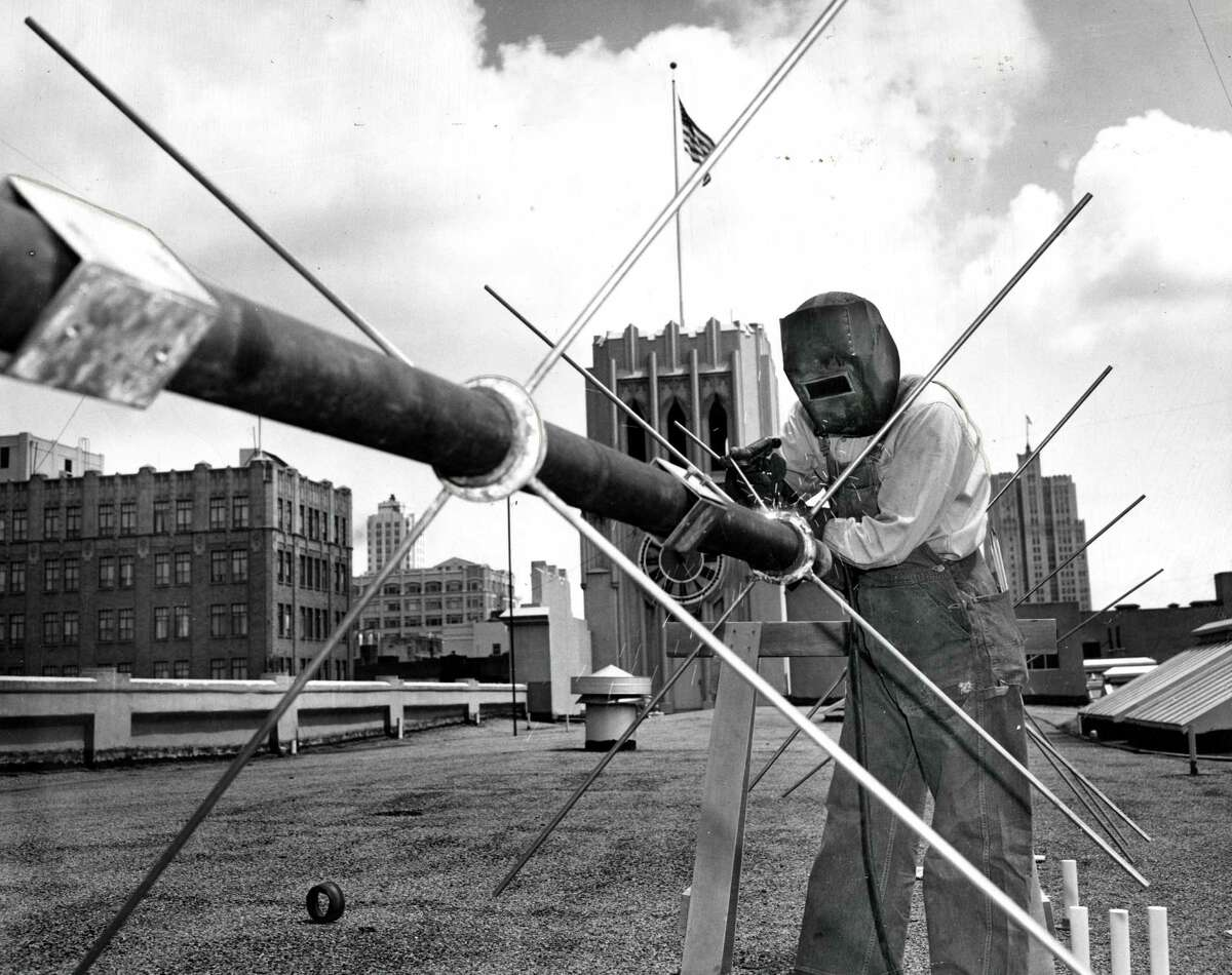 Antenna for radio station KRON being installed on top of the San Francisco Chronicle building Phot0 ran 6/16/1947