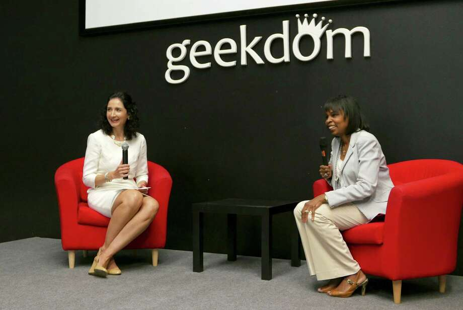 Mayor Ivy Taylor (right) talks tech sector development with WP Engine CEO Heather Brunner at Geekdom in San Antonio on Friday. WP Engine, which supports websites and applications built on WordPress, was celebrating its one-year anniversary at Geekdom. Photo: Billy Calzada /San Antonio Express-News / San Antonio Express-News