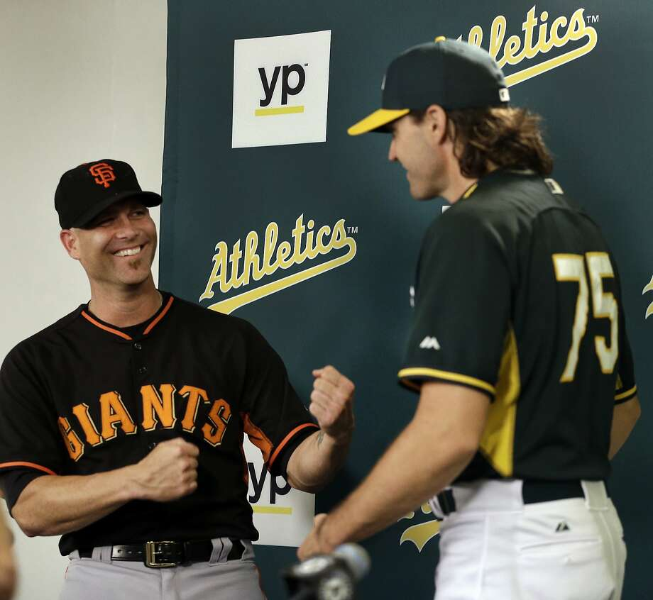 San Francisco Giants pitcher Tim Hudson, left, and Oakland Athletics pitcher Barry Zito gesture after a media conference prior to their baseball game Friday, Sept. 25, 2015, in Oakland, Calif. (AP Photo/Ben Margot) Photo: Ben Margot, Associated Press
