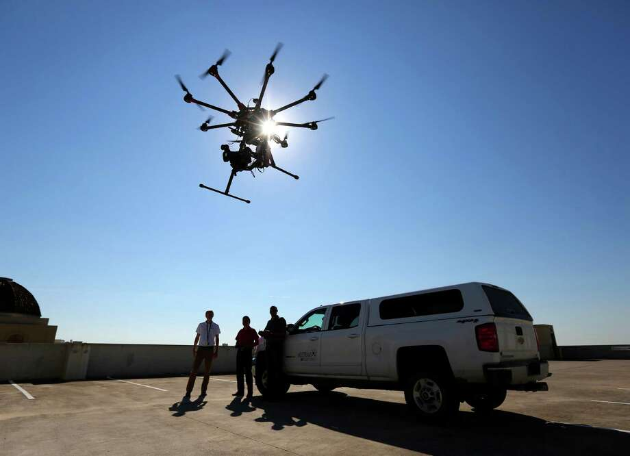One of Midstream Integrity's octocopters performs during a recent demonstration flight. Midstream Integrity is an FAA-approved drone service provider specializing in the oil and gas industry services. Photo: William Luther, Staff / © 2015 San Antonio Express-News