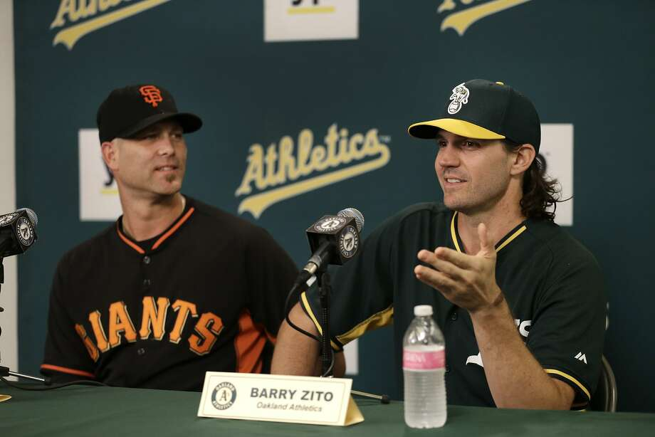 Tim Hudson (left) and Barry Zito discuss Saturday's head-to-head reunion in Oakland. Photo: Ben Margot, Associated Press