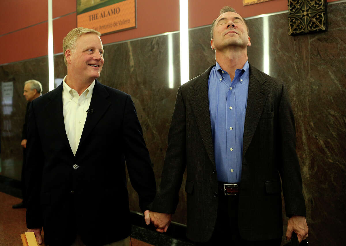 Mark Phariss, left, and Vic Holmes wait for the elevator moments after getting their marriage license at the Bexar County Marriage License Office in the Paul Elizondo Tower in San Antonio on Friday, Sept. 25, 2015.