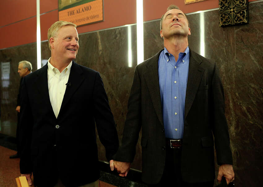 Mark Phariss, left, andVic Holmeswait for the elevator moments after getting their marriage license at the Bexar County Marriage License Office in the Paul Elizondo Tower in SanAntonio on Friday, Sept. 25, 2015.