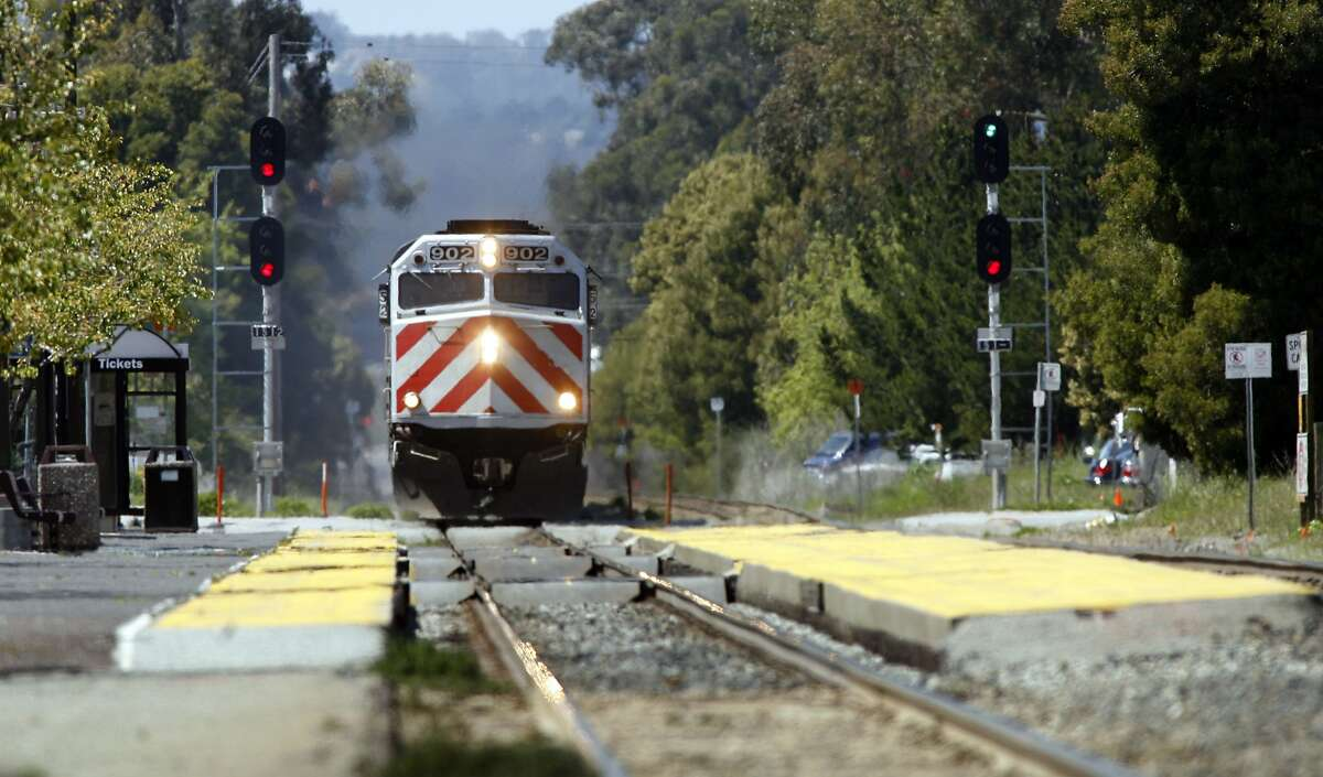 In this file photo a CalTrain passenger train passes through Burlingame. A northbound train going through Burlingame struck a trespasser on the tracks Monday morning, creating major delays.