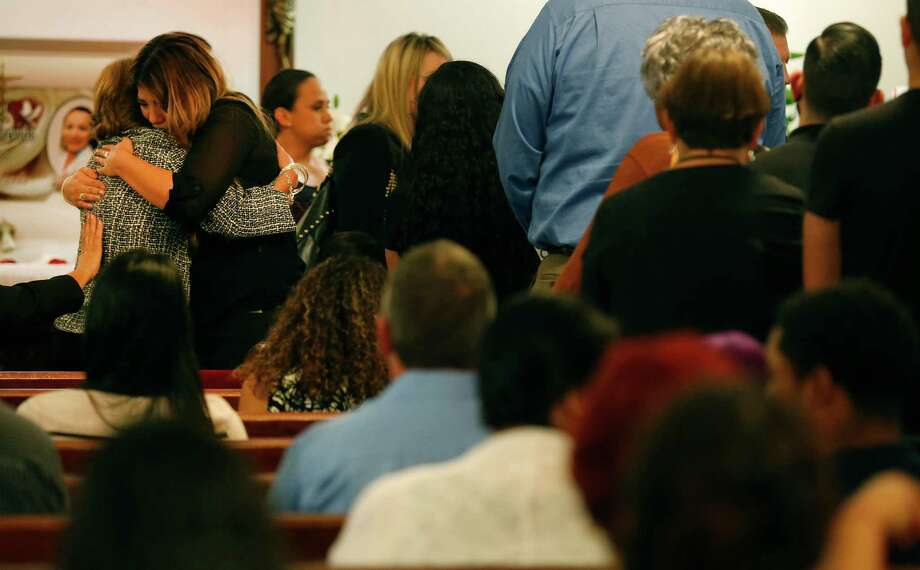Teresa Garza, mother of Geraldine Trevino, receives a hug from a mourner during visitation services at Castle Ridge Morturary on Friday, Sept. 25, 2015. Trevino died when a suspect who stole a pickup ran into her vehicle near Huebner and IH-10 on Monday. Mourners packed a chapel to bid farewell to Trevino and to offer their condolences to her family. Trevino is survived by her husband Alfonso who is recovering from the accident and by two young sons, Alfonso, Jr. and Christian.  (Kin Man Hui/San Antonio Express-News) Photo: Kin Man Hui, Staff / San Antonio Express-News / ©2015 San Antonio Express-News