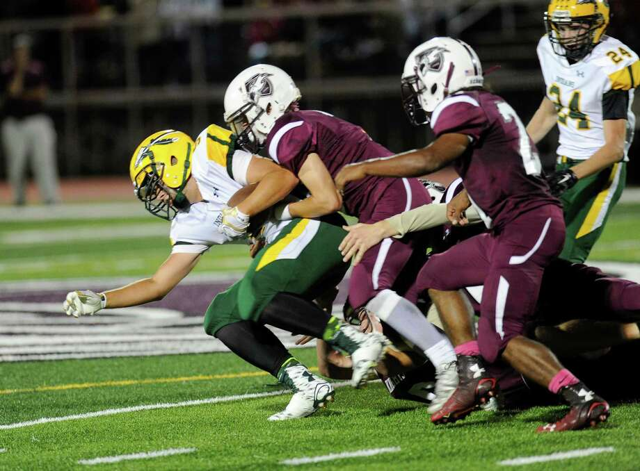 Ravena's Matt Ferriero, left, runs for a touchdown against Lansingburgh during a Class B high school football game in Lansingburgh, N.Y., Friday, Sept. 25, 2015. (Hans Pennink / Special to the Times Union) ORG XMIT: HP104 Photo: Hans Pennink / 10033491A