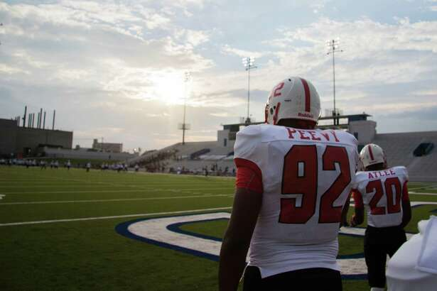 Bellaire Cardinals' defensive lineman Jayden Peevy (92) takes the field for pregame warm-ups at a high school football game at Delmar Stadium on Friday, September 25, 2015, in Houston.
