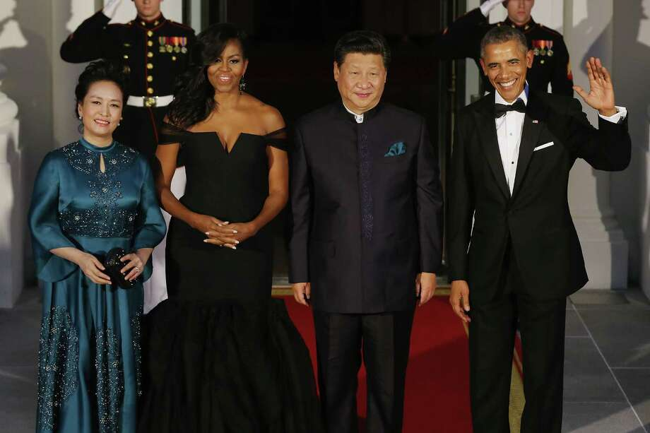 Madame Peng Liyuan, first lady Michelle Obama, Chinese President Xi Jinping and President Barack Obama arrive for Friday night's state dinner at the White House.  Photo: Chip Somodevilla, Staff / 2015 Getty Images