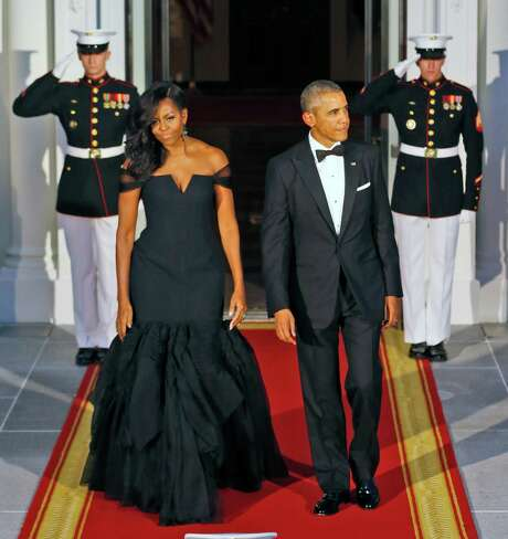 Michelle Obama wore black to the White House state dinner for Chinese President, Xi Jinping, and his wife, Peng Liyuan. Photo: Steve Helber, AP / AP