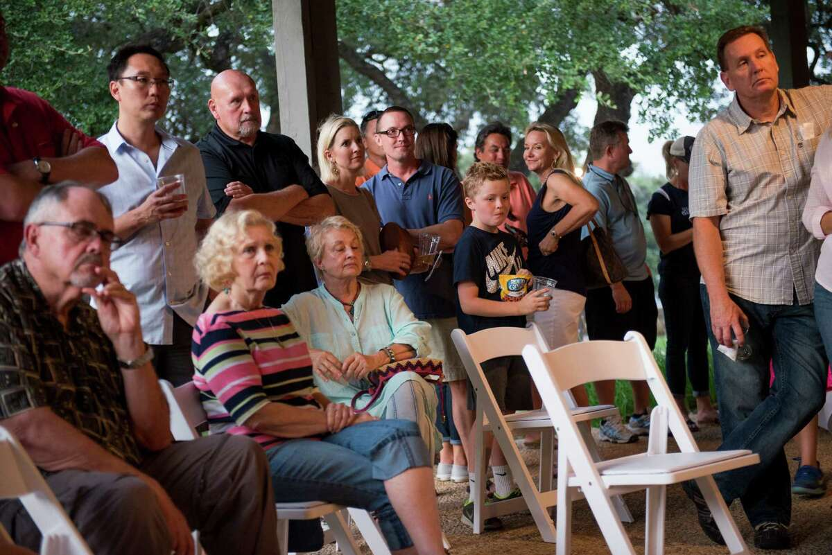 Residents listen to a speaker during an informational rally where fourteen neighborhood associations, off the U.S. 281 corridor, expressed their opposition to the city of San Antonio's plans to annex them at Canyon Springs Golf Club on Friday, September 25, 2015.