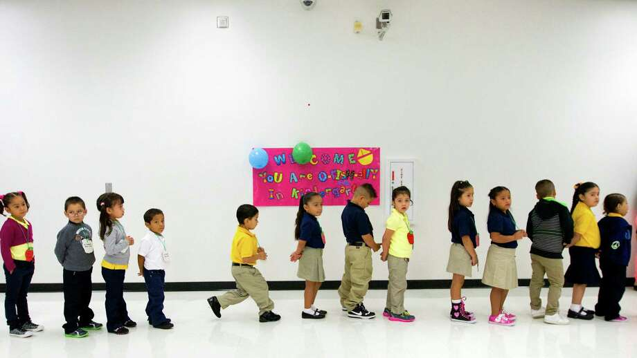Pupils line up during the first day of school at Thurgood Marshall Elementary, Monday, Aug. 26, 2013, in Houston (Cody Duty / Houston Chronicle) Photo: Cody Duty, Staff / © 2013 Houston Chronicle