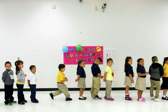 Pupils line up during the first day of school at Thurgood Marshall Elementary, Monday, Aug. 26, 2013, in Houston (Cody Duty / Houston Chronicle)